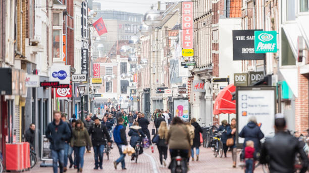 Shopping street retail in Europe Horizontal color image of typical shopping street in Western Europe leiden stock pictures, royalty-free photos & images