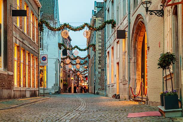shopping street with christmas lights in maastricht - maastricht stockfoto's en -beelden