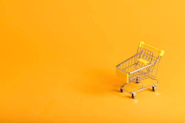 Shopping theme with shopping cart stock photo