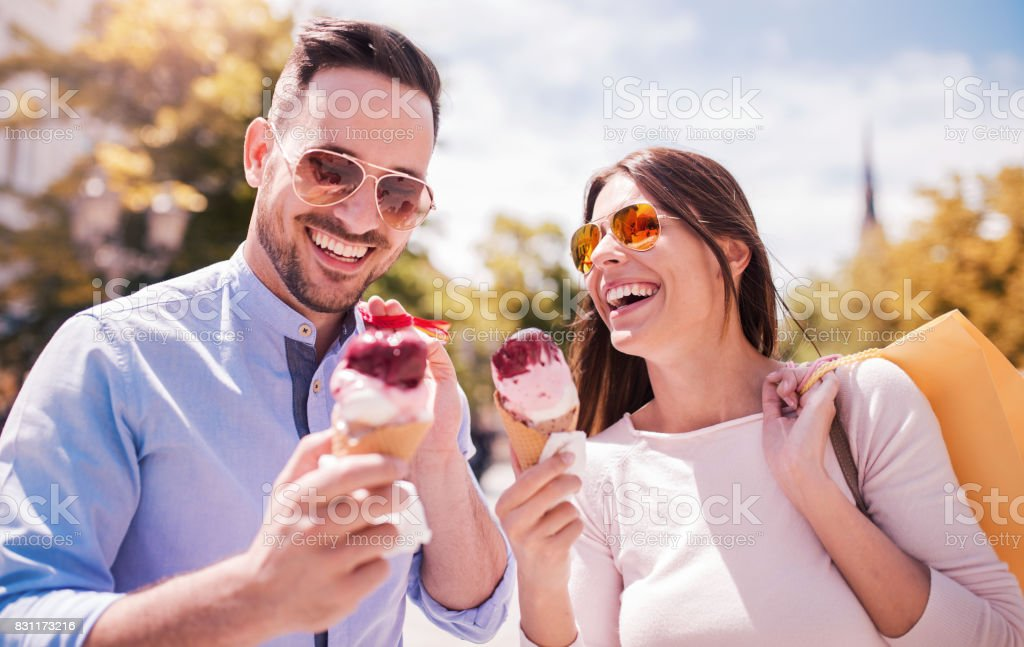 Shopping time. Beautiful couple in shopping. Consumerism, shopping, lifestyle concept stock photo