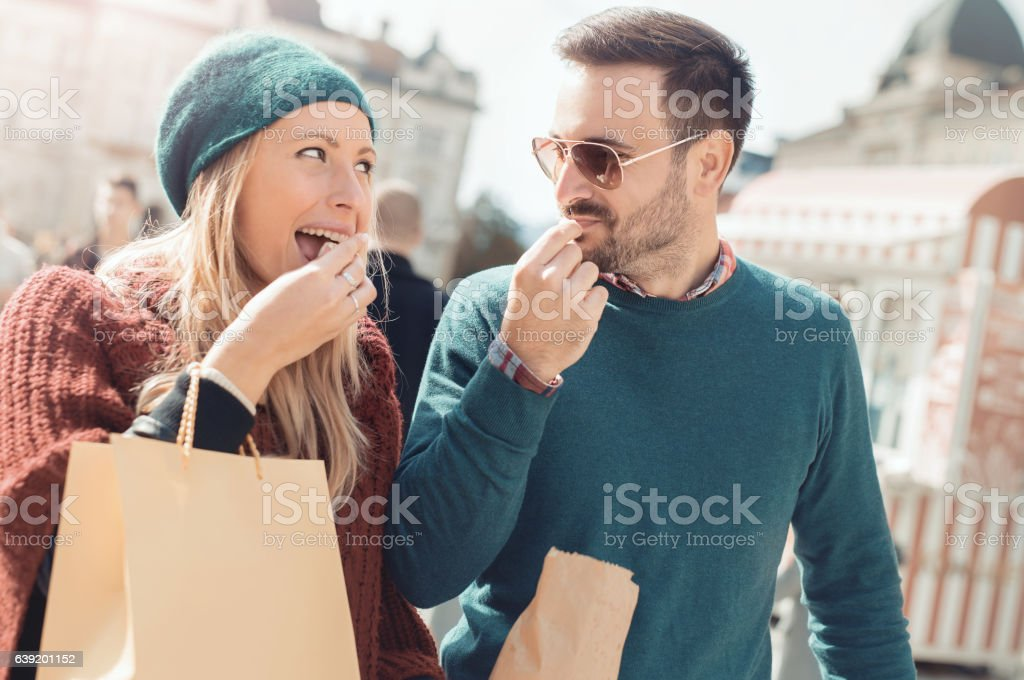 Shopping time. Beautiful  young couple in shopping. Consumerism, stock photo