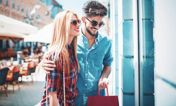 Shopping time. Young couple in shopping. Consumerism, love, dating, lifestyle concept stock photo