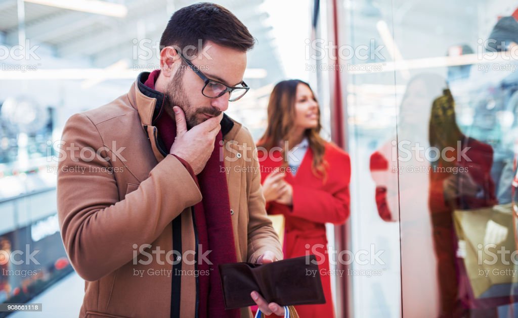Shopping time. Young couple shopping together in shopping mall. Consumerism, love, dating, lifestyle concept stock photo