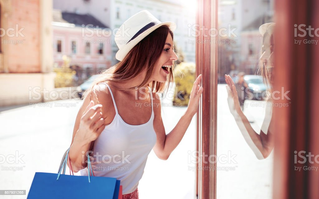 Shopping time. Young woman in shopping looking for presents. Consumerism, shopping, lifestyle concept stock photo