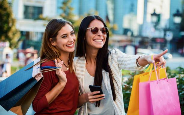 Shopping time. Young women shopping together. Consumerism, fashion, lifestyle stock photo