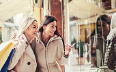 istock Shopping time. Young women shopping together. Consumerism, shopping, lifestyle 1061417088