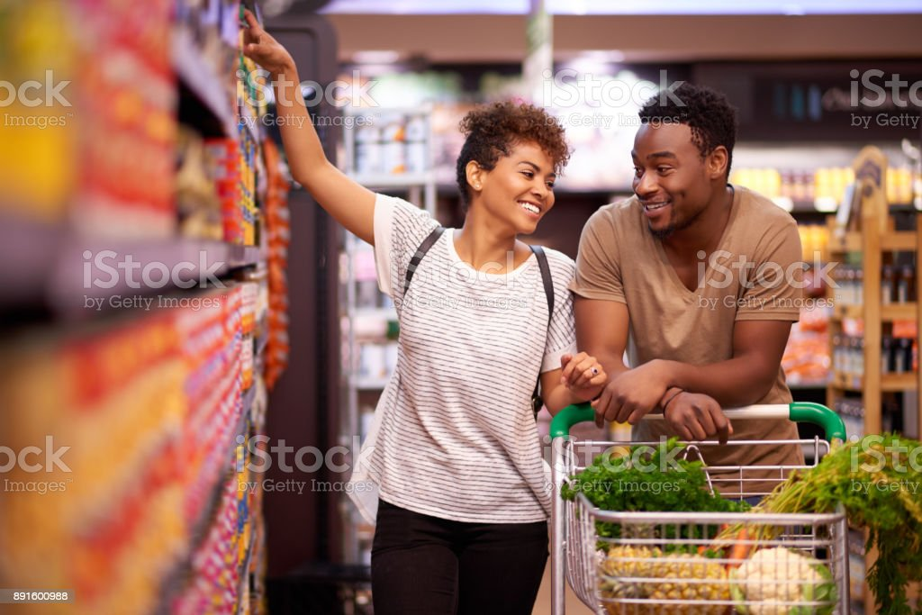 Shopping together for all their essentials stock photo