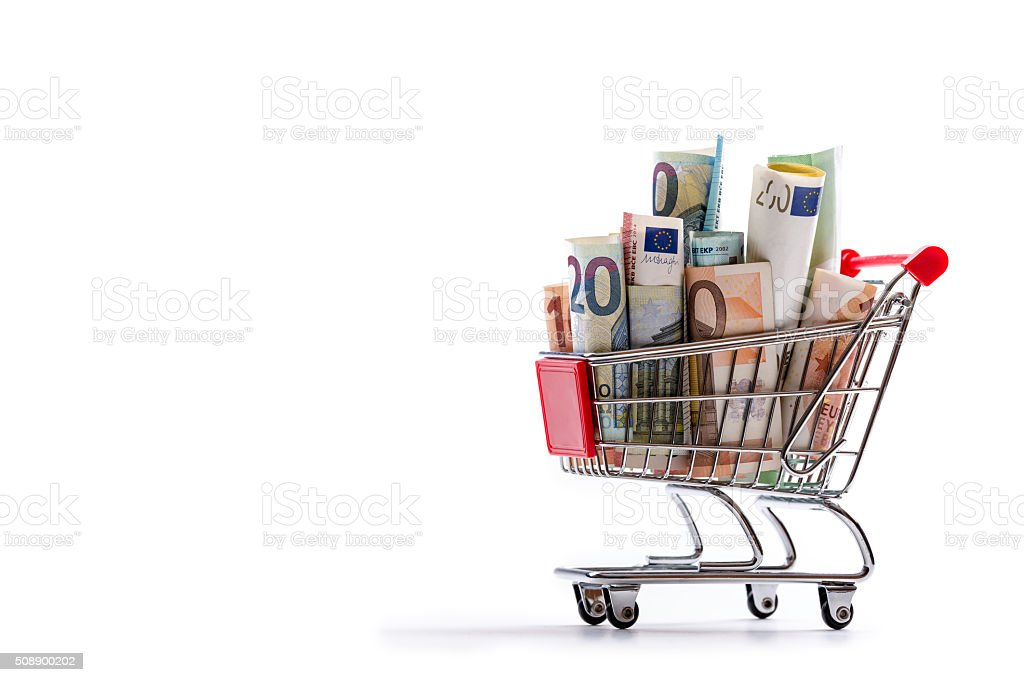 Shopping trolley full of euro money - banknotes - currency. stock photo