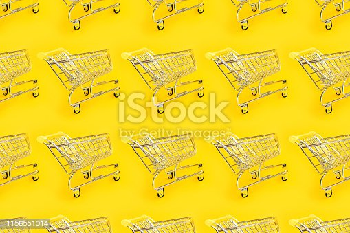 Shopping trolley on a yellow background. Modern trendy design for any purposes.