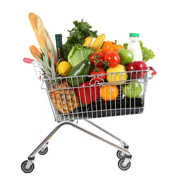 a shopping trolley overloaded with fresh food - full stock photos and pictures