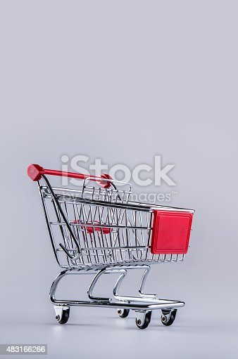 511190632istockphoto Shopping trolley. Shopping cart. Shopping trolley on muti collored background. 483166266