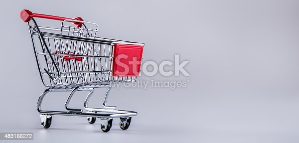 511190632istockphoto Shopping trolley. Shopping cart. Shopping trolley on muti collored background. 483166272