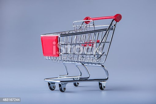 511190632istockphoto Shopping trolley. Shopping cart. Shopping trolley on muti collored background. 483167244