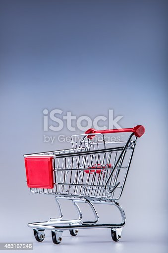 511190632istockphoto Shopping trolley. Shopping cart. Shopping trolley on muti collored background. 483167246