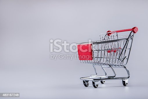 511190632istockphoto Shopping trolley. Shopping cart. Shopping trolley on muti collored background. 483167248