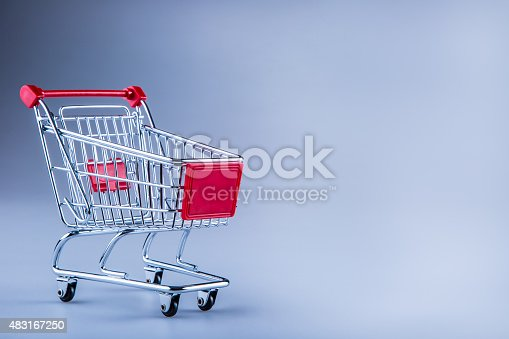 511190632istockphoto Shopping trolley. Shopping cart. Shopping trolley on muti collored background. 483167250