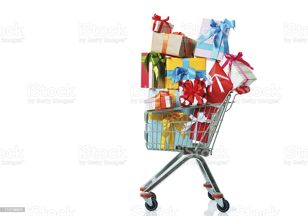 Shopping trolley with Christmas gifts royalty-free stock photo
