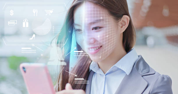 shopping with facial recognition A business woman is shopping on smart phone with scanning facial recognition. biometrics stock pictures, royalty-free photos & images