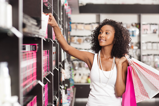 istock Shopping woman at beauty store. 499607840
