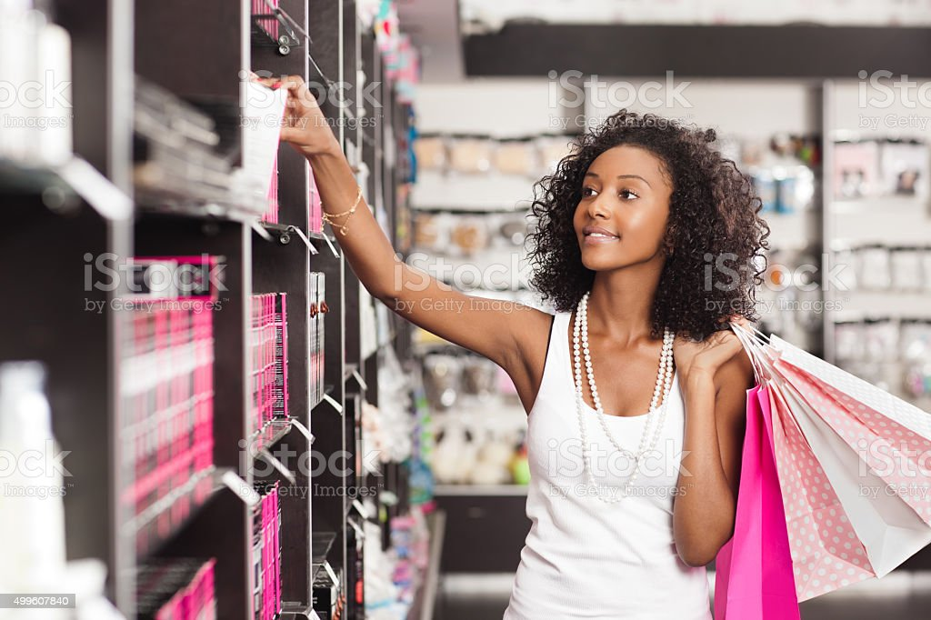 Shopping woman at beauty store. stock photo