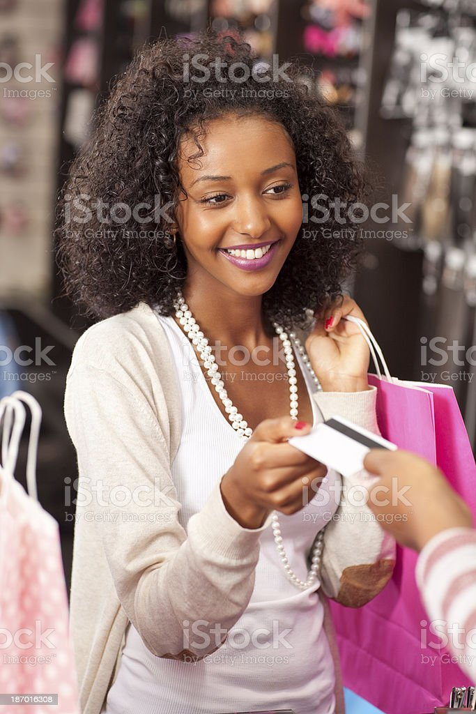 Shopping woman at the checkout paying by card. royalty-free stock photo