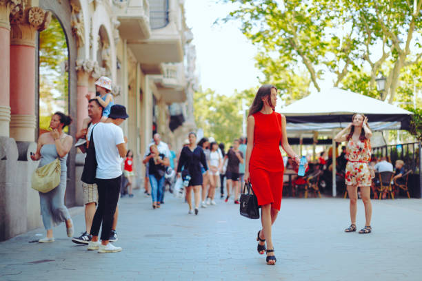 Shopping woman, Barcelona - Spain Barcelona, Spain - June 26, 2017: A confident young woman in red dress is walking on the Passeig De Gracia. passeig de gracia stock pictures, royalty-free photos & images