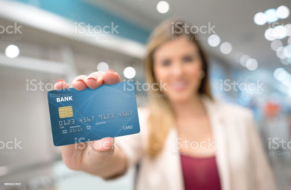 Shopping woman holding a credit card - Royalty-free Adult Stock Photo