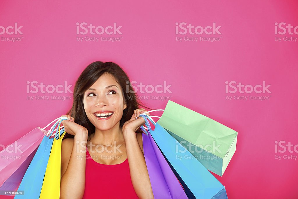 Shopping woman holding bags stock photo