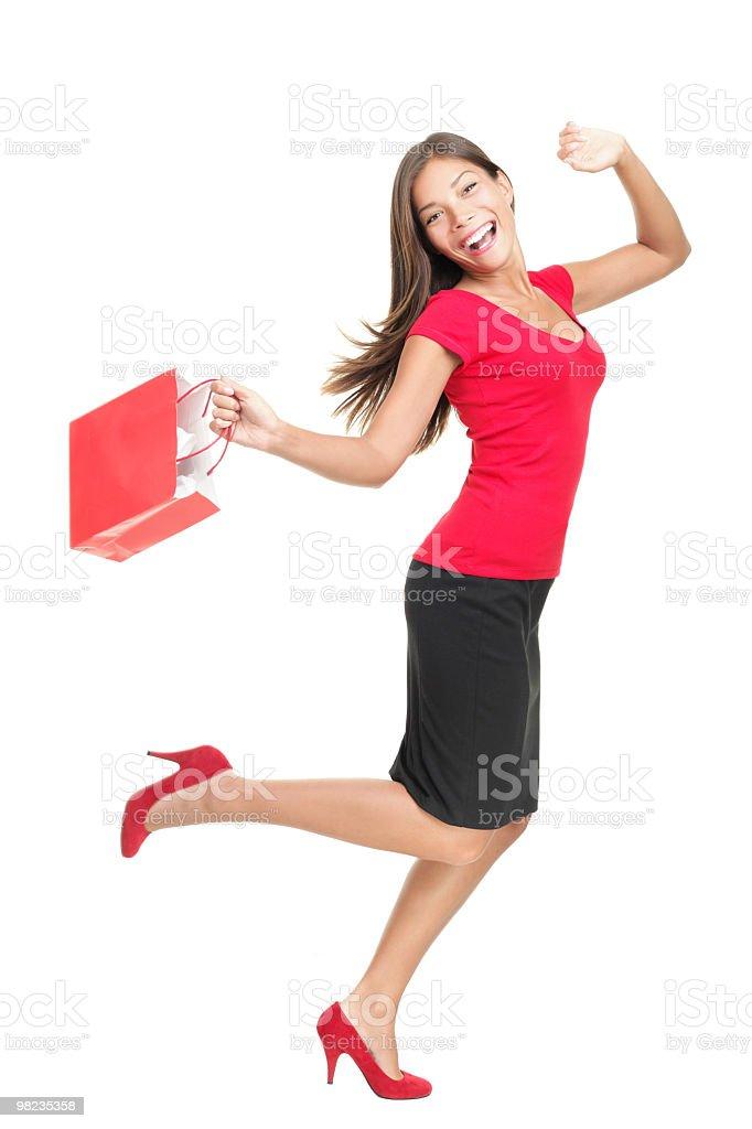 Shopping woman in joy running holding bag royalty-free stock photo