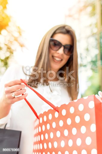 531536422istockphoto Shopping woman in the city 866976966