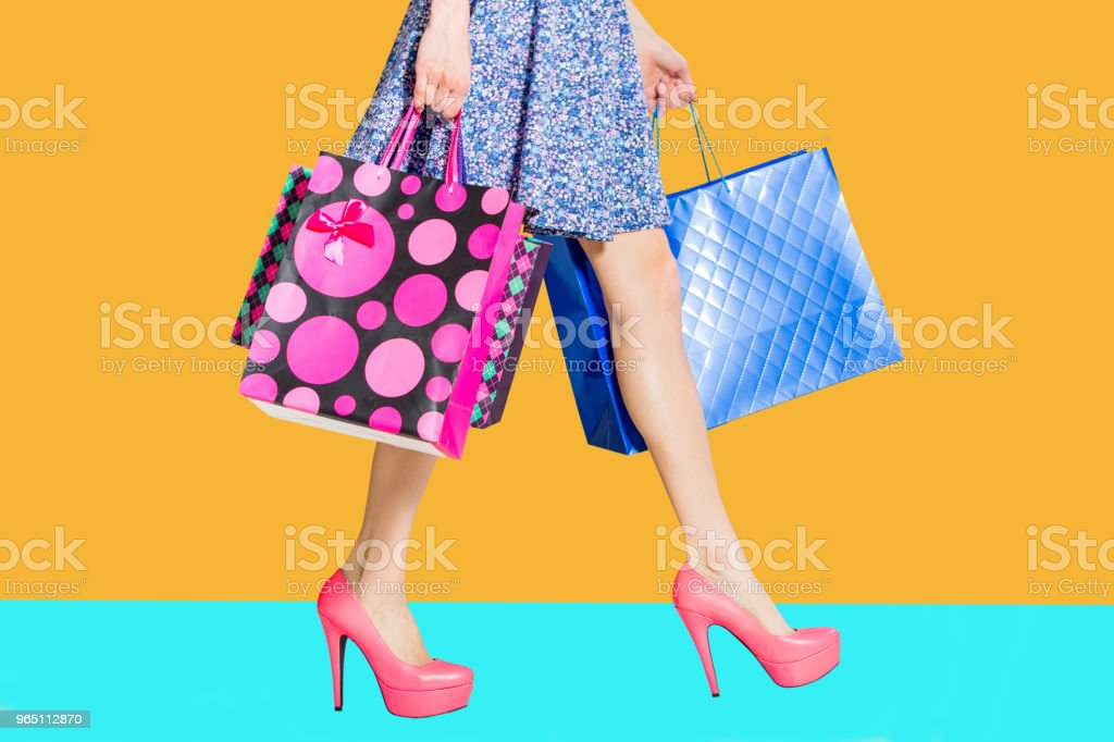 Shopping woman legs with shopping bags zbiór zdjęć royalty-free