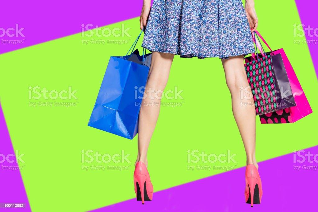 Shopping woman legs with shopping bags zbiór zdjęć royalty-free