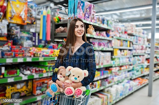 926078666 istock photo Shopping woman looking at the shelves in the supermarket 1006670552