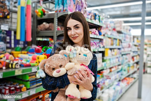 926078666 istock photo Shopping woman looking at the shelves in the supermarket 1006670568