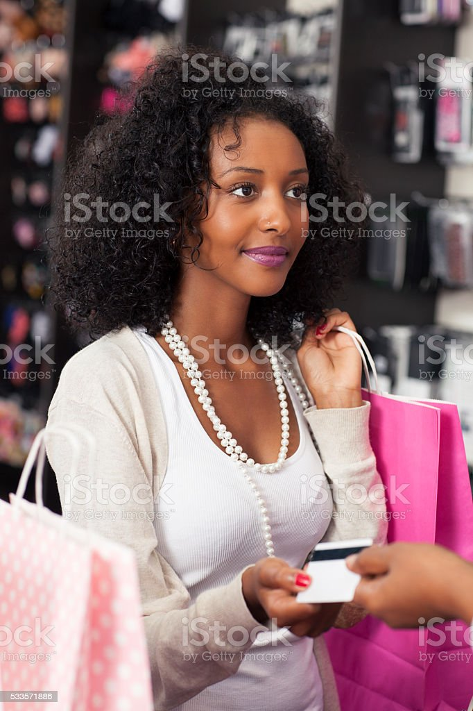 Shopping woman paying by card. stock photo