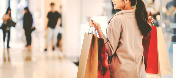 Shopping woman Lifestyle shopping concept, Young happy asian woman with paper bag and coat in shopping mall, vintage style buying stock pictures, royalty-free photos & images