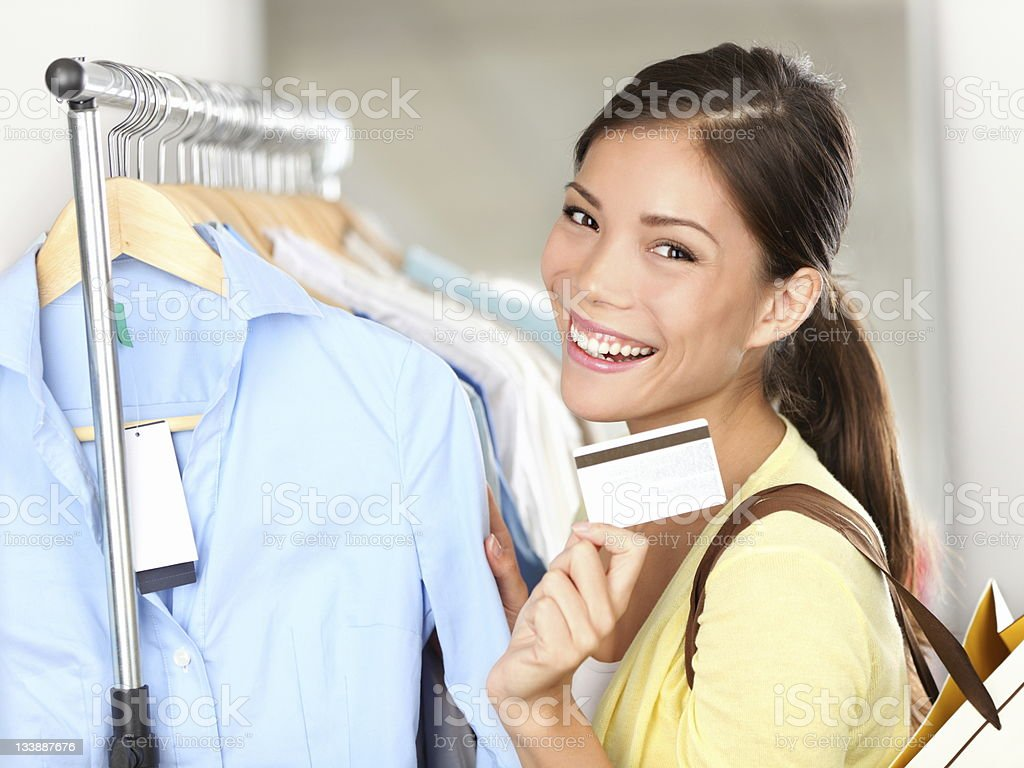 Shopping woman showing credit card royalty-free stock photo