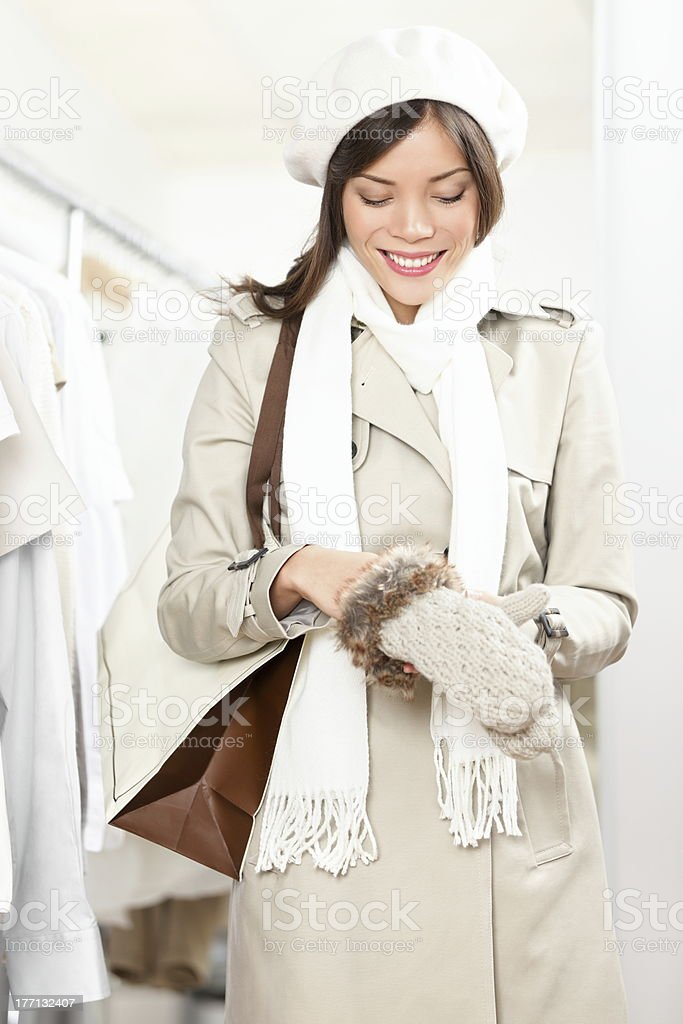 Shopping woman trying winter gloves stock photo