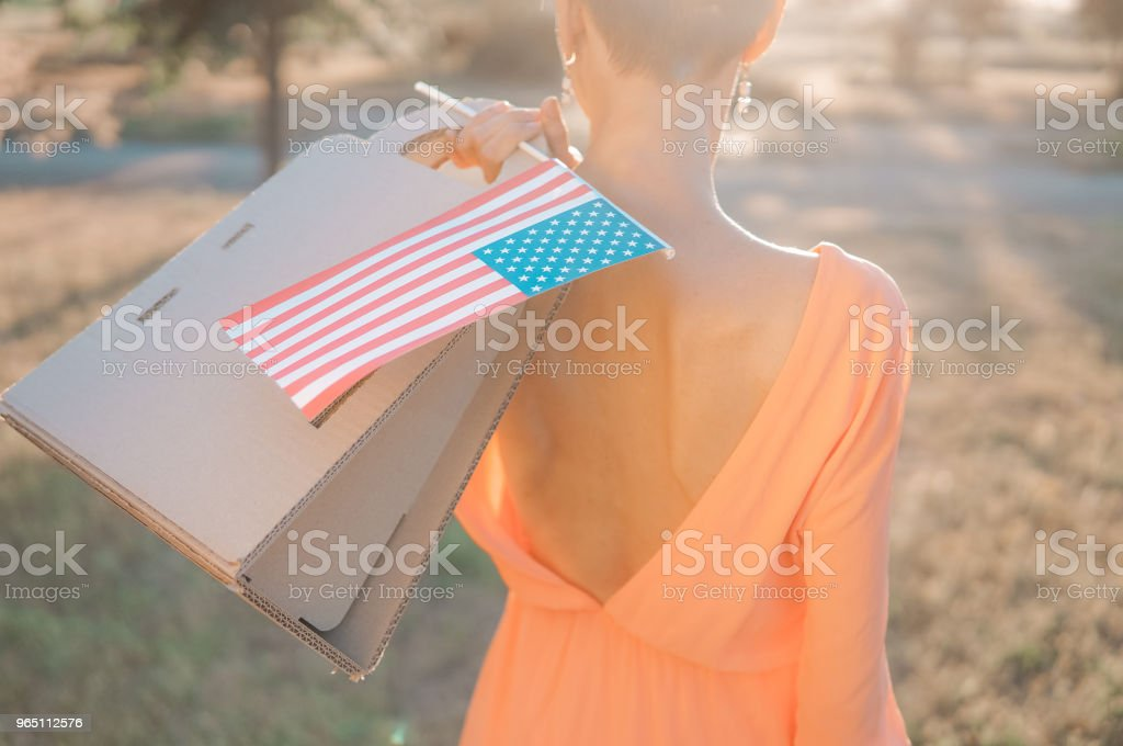 Shopping woman with american flag royalty-free stock photo
