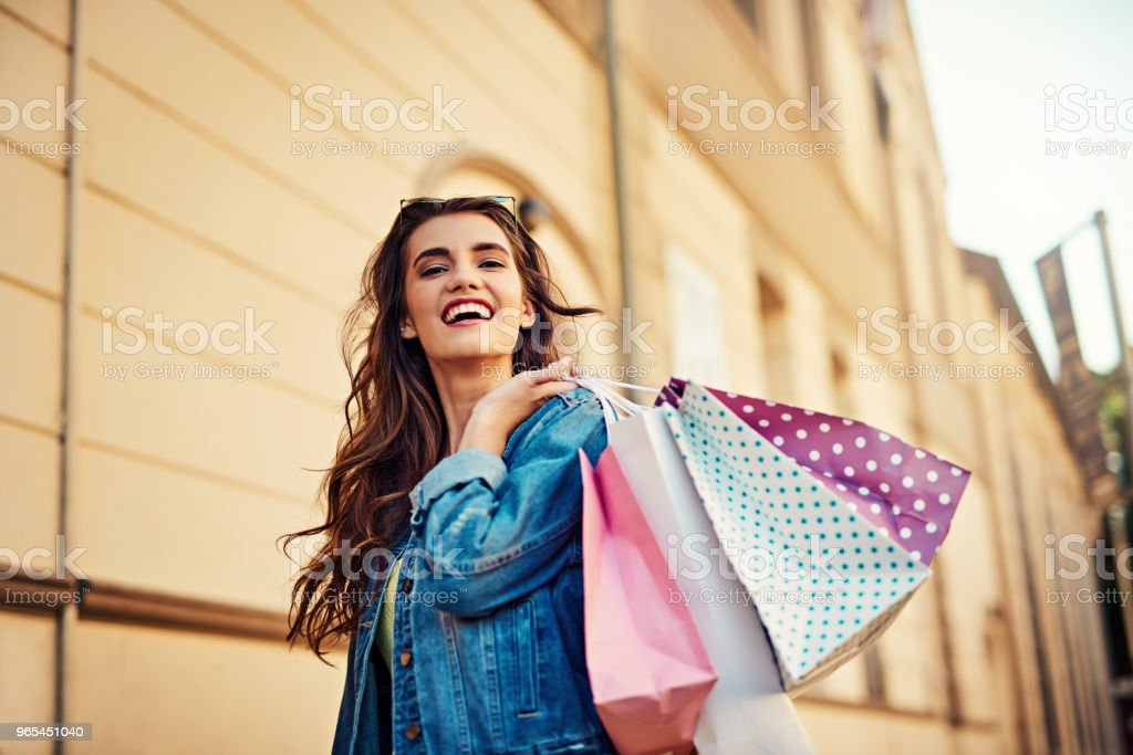 Shopping would put a smile on any girls face zbiór zdjęć royalty-free