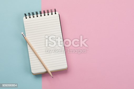 Spiral Notebook on blue and pin background