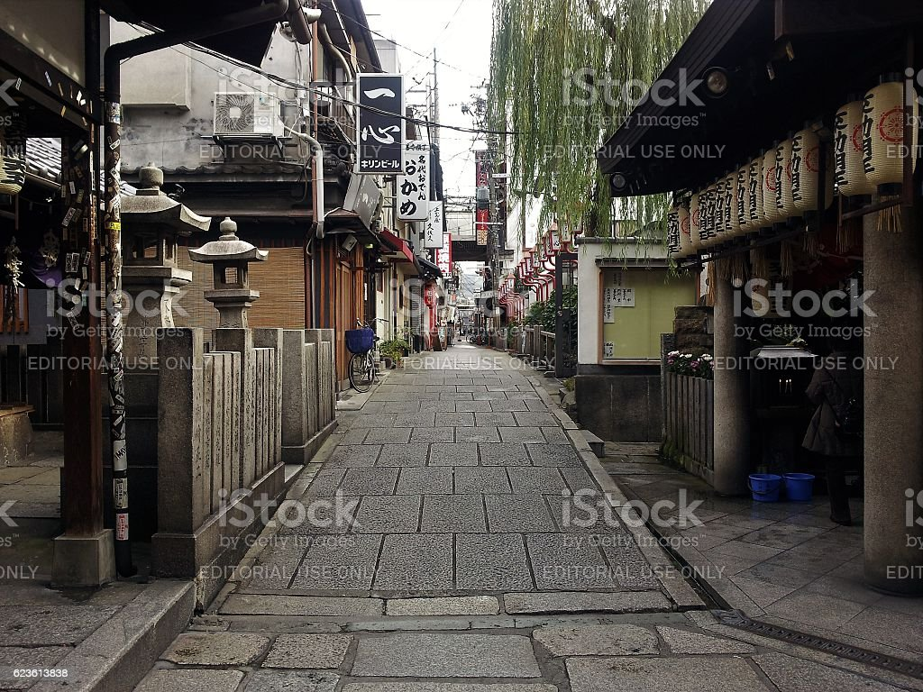 Shops and a shrine on the street in Osaka, Japan stock photo