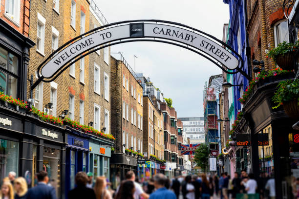 Shops and restaurants in Carnaby Street London Street view in London's Carnaby carnaby street stock pictures, royalty-free photos & images