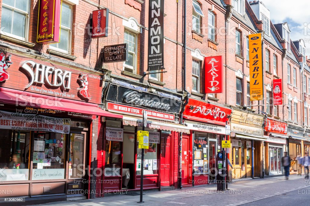 Shops and restaurants on Brick Lane in London stock photo