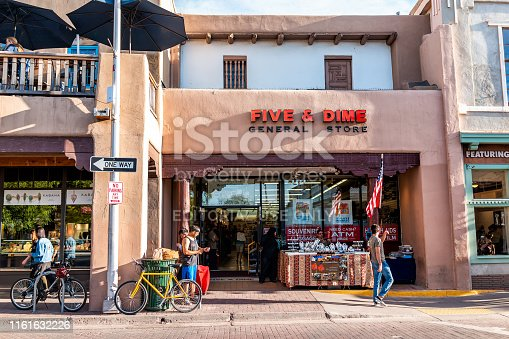 Santa Fe, USA - June 14, 2019: Shops on old town street in United States New Mexico city with adobe style architecture