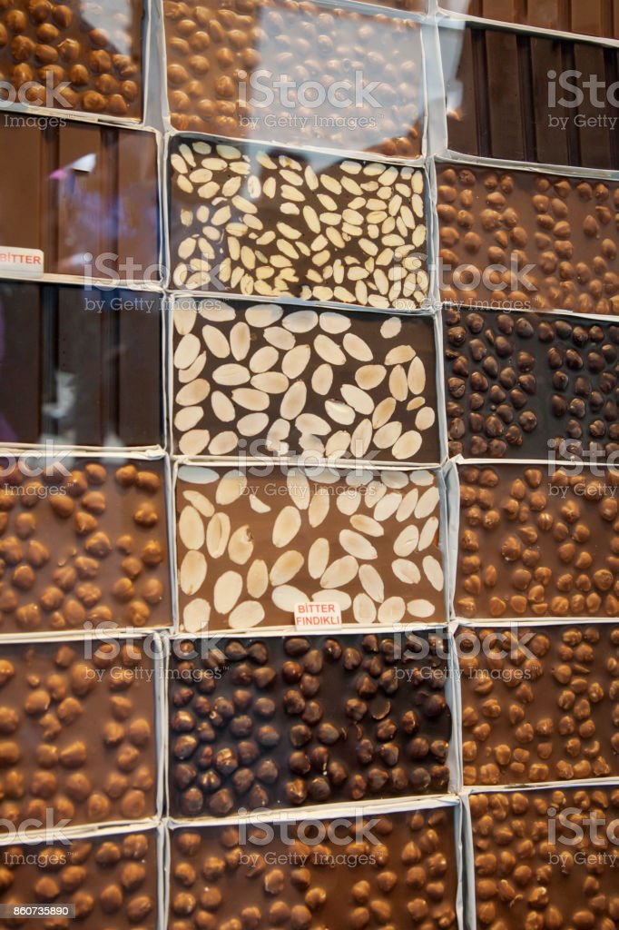 Shop-window with different variety of chocolate. Sweet food and desserts. stock photo