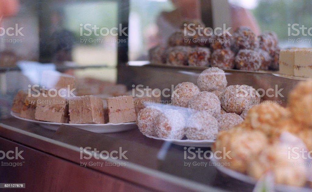 Shopwindow with indian milk sweets burfi. Shot on film stock photo