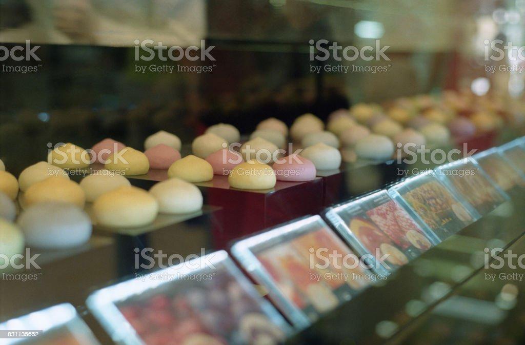 Shopwindow with japanese sweet rice cakes mochi. Shot on film stock photo
