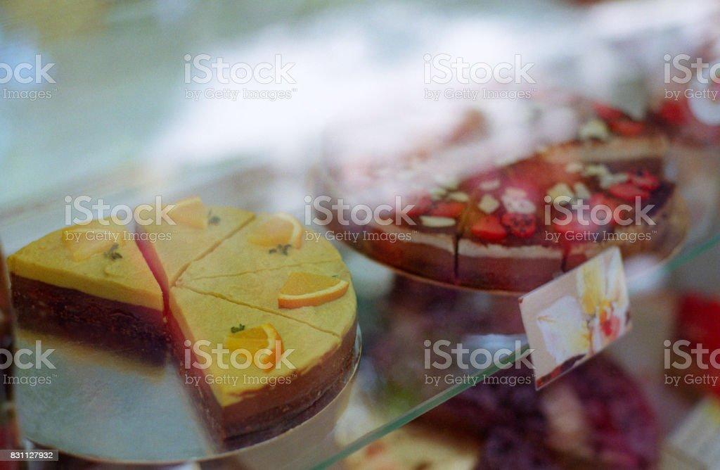Shopwindow with raw cakes. Shot on film stock photo