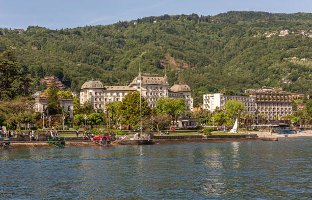 Shore line of Stresa, the prominante Regina Palace building on the foreshore. People around the lake enjoying the summers sun stock photo